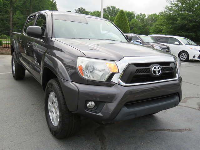 Pre-Owned 2012 Toyota Tacoma 4WD Double Cab V6 AT (Natl)